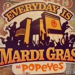 It's Mardi Gras everyday at Popeyes....Superfry had to restrain the Big Ragu from lifting his top in order to get beads.